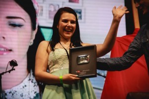 Cherry picked up a silver play button award for hitting 100K subscribers at Summer in the City 2014