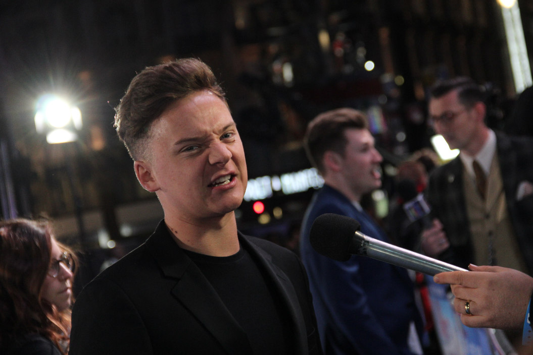 Conor Maynard looking scary for the media on the blue carpet
