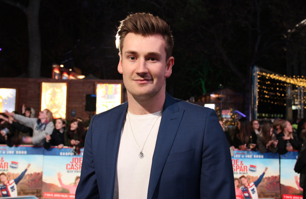 Oli White posed for media on the blue carpet